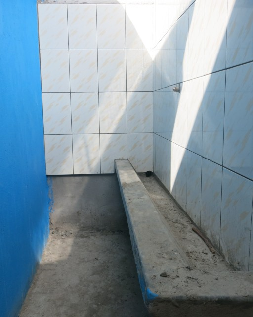 Construction at the boys' urinal at the St Francis Madera school for the blind in Uganda.