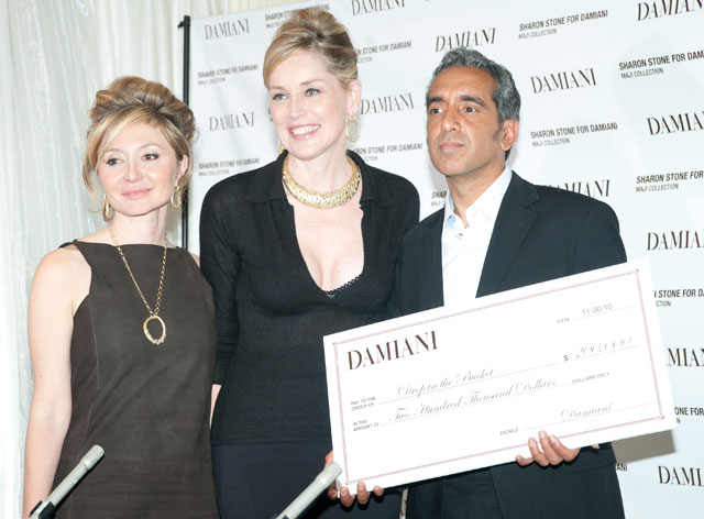 Sharon Stone and Silvia Damiani present John Travis from Drop in the Bucket with a check from the proceeds from the Maji Collection.