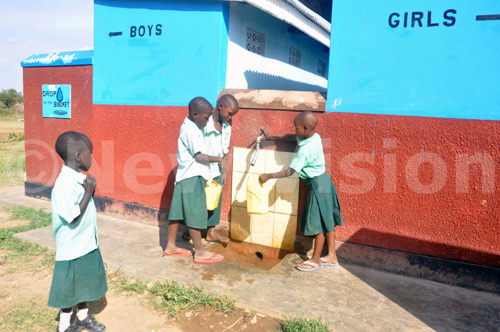 New Vision Uganda - Drop in the Bucket - pupils of Hope Junior School washing their hands after visiting bio-digestion toilets.