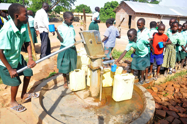 New-Vision-Uganda-Drop-in-the-Bucket - Pupils of Hope Junior School fetching water connected to flush toilets in Soroti district using new technology.