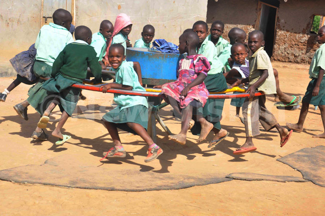 New-Vision-Uganda-Drop-in-the-Bucket pupils of Hope Junior School in Soroti district playing using a wheel pump that is used in the new technology.