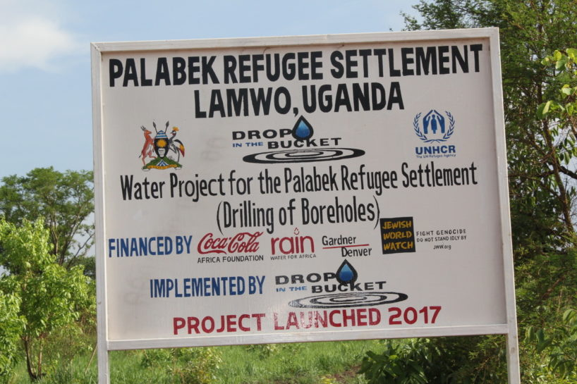 World Refugee Day - Sign for the Palabek Refugee Settlement, Lamwo, Uganda.