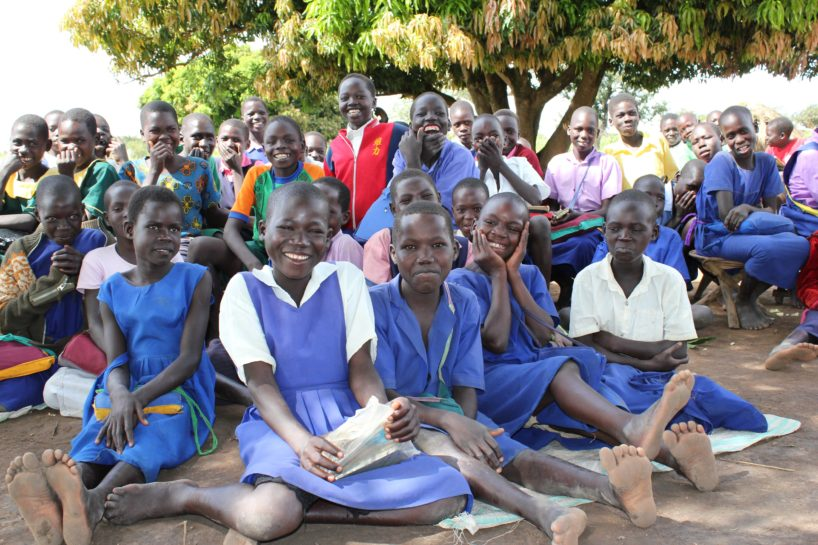 A large group of students in Uganda smile for Drop in the Bucket