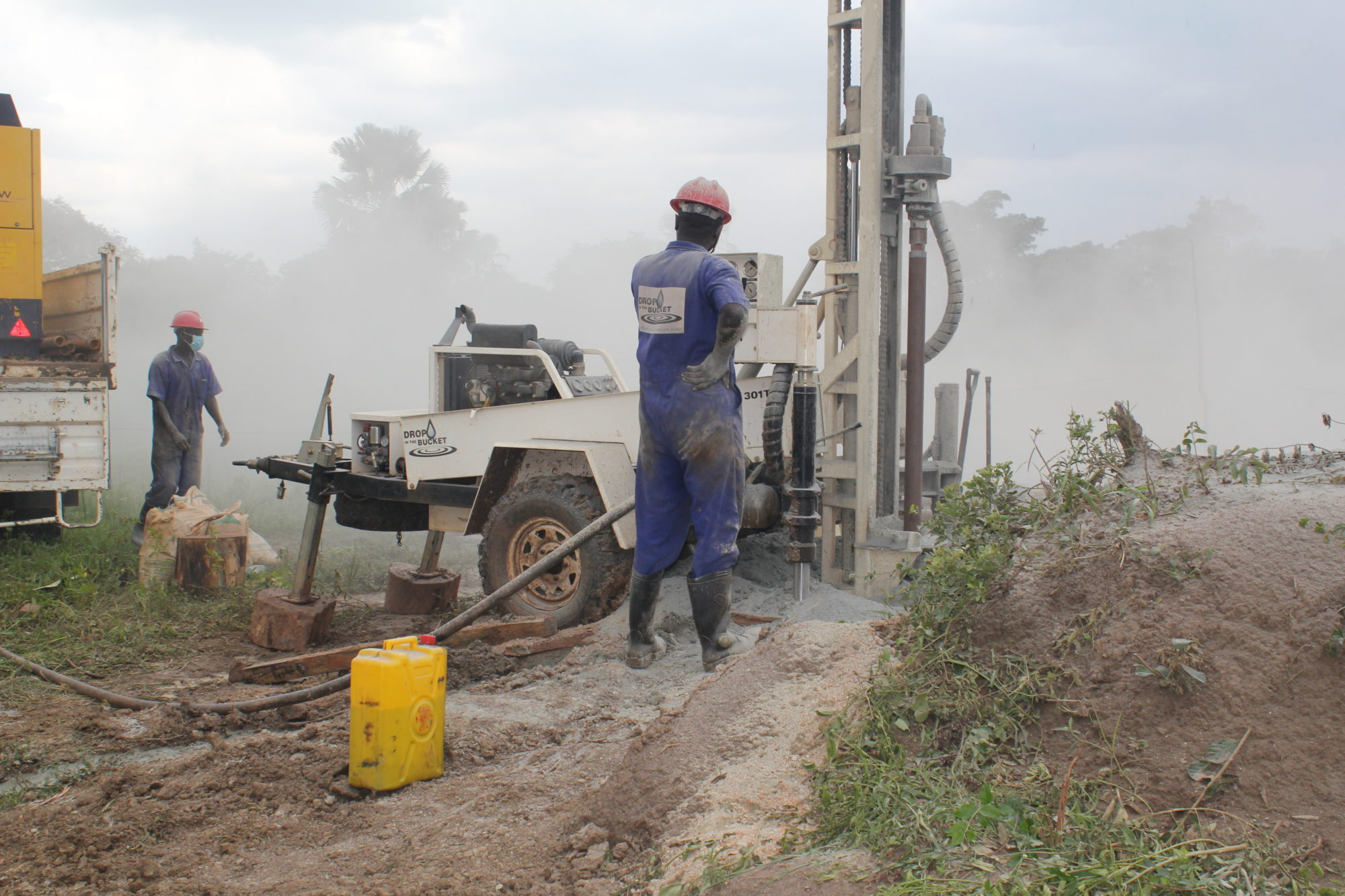 Drop in the Bucket team members drilling a well in northern Uganda